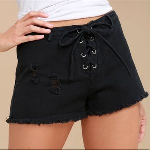Black distressed denim lace-up shorts